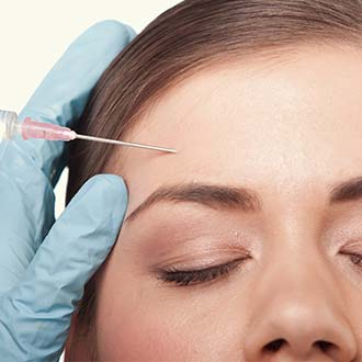 Woman Receiving Botox Treatment